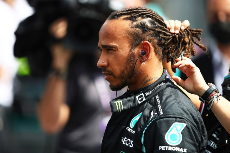Lewis Hamilton and Toto Wolf motivate